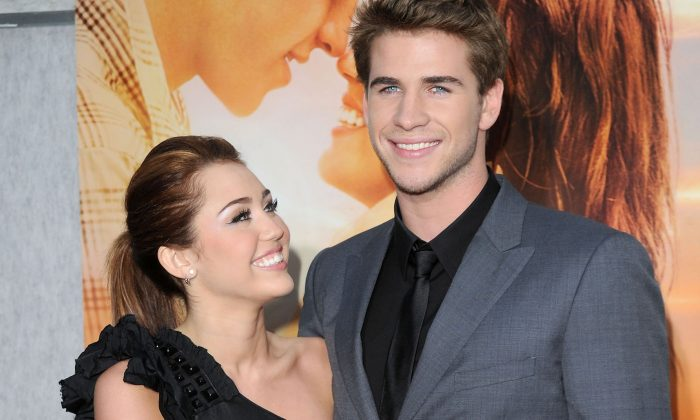"Miley Cyrus and Liam Hemsworth arrive at ""The Last Song"" premiere in Hollywood, March 25, 2010. (Jason Merritt/Getty Images)"