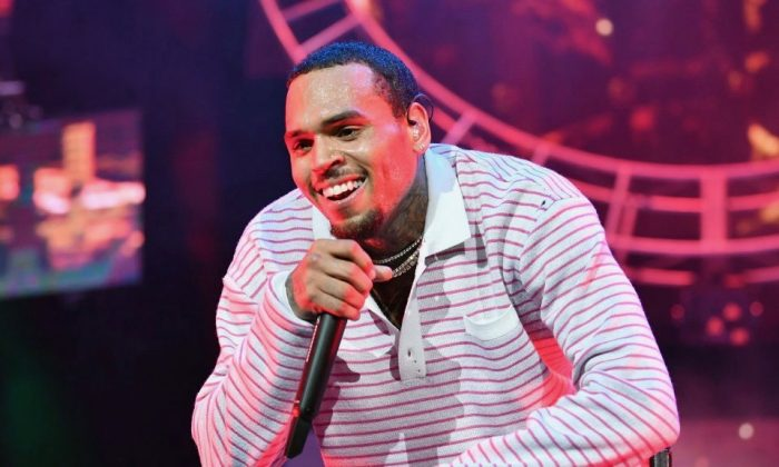 Chris Brown performs at 2018 BET Experience Staples Center Concert, sponsored by COCA-COLA, at L.A. Live in Los Angeles on June 22, 2018. (Earl Gibson III/Getty Images for BET)