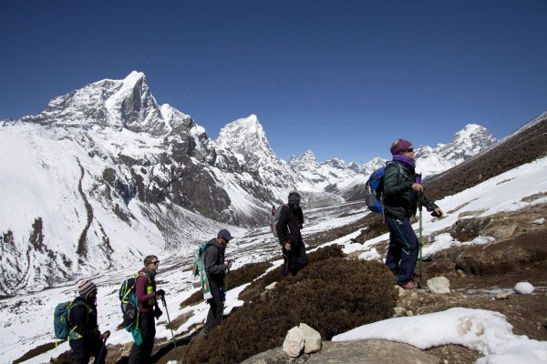 people are climbing up the valley to get to the everest camp