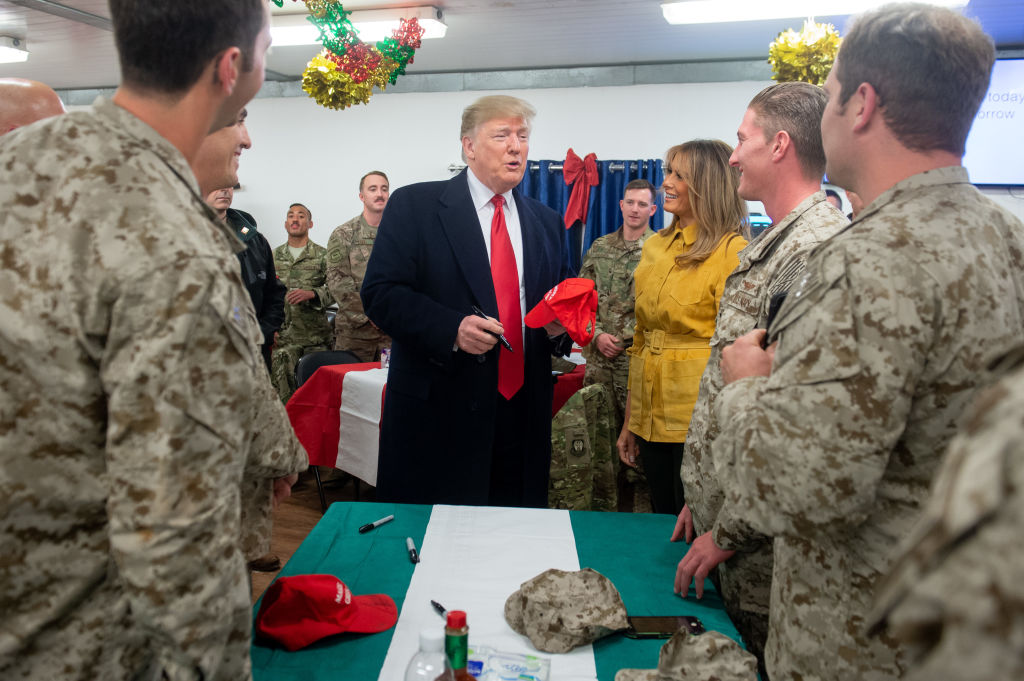 trump signing troops hat