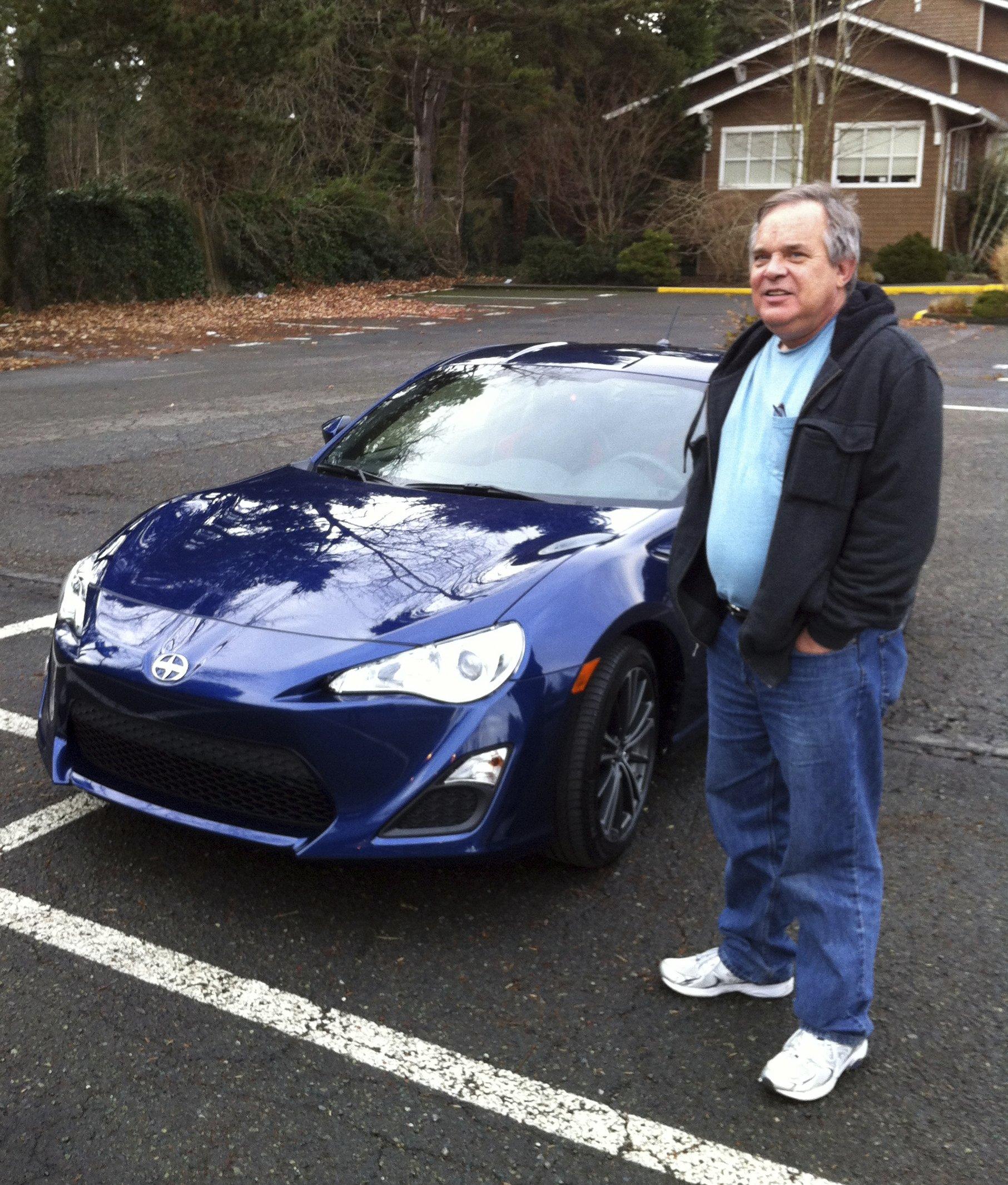 Alan Naiman poses with his new car