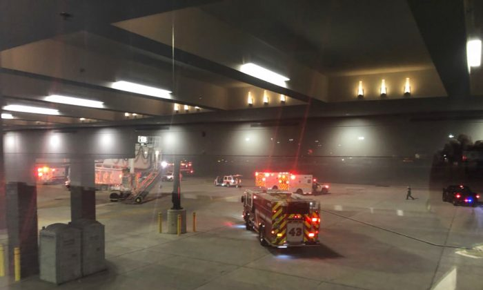 "Emergency personnel responding after an ""equipment failure"" involving a jet bridge at Baltimore-Washington International Thurgood Marshall Airport, on Dec. 29, 2018, in Baltimore. (Lynn Krugman via AP)"