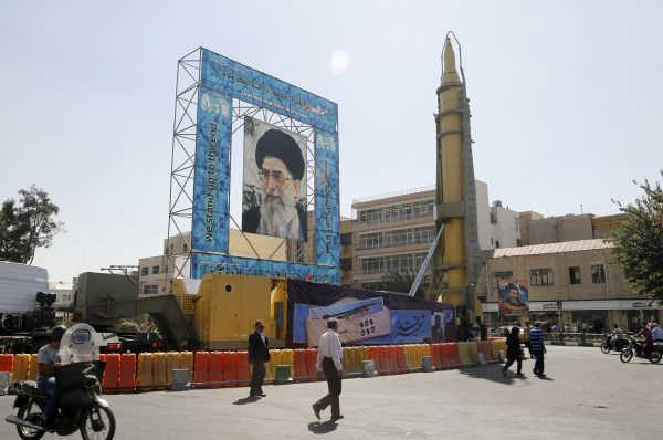 A Ghadr-F missile is displayed next to a portrait of Iran's Supreme Leader Ayatollah Ali Khamenei in Tehran, Iran, on Sept. 26, 2016. (Atta Kenare/AFP/Getty Images)