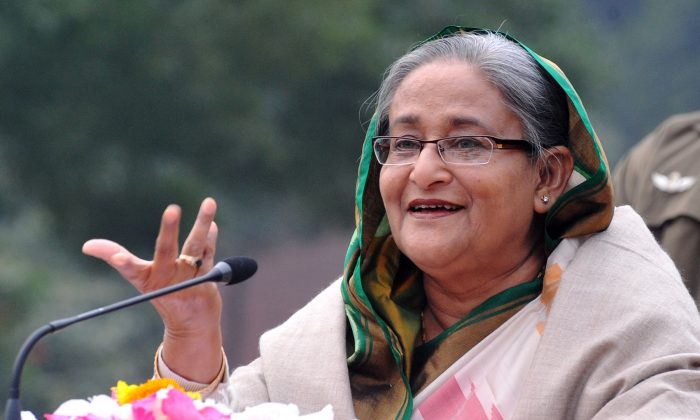 Bangladesh Prime Minister Sheikh Hasina gestures while speaking during a press conference after the national election in Dhaka on January 6, 2014. Bangladesh's Prime Minister Sheikh Hasina won the Dec. 30, 2018 general elections with a landslide victory and is expected to form government for the third consecutive time. (STR/AFP/Getty Images)