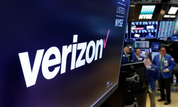The logo for Verizon above a trading post on the floor of the New York Stock Exchange on Apr. 23, 2018. (AP Photo/Richard Drew)