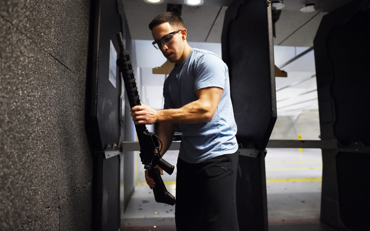 A man locks up his guns after a training at the RTSP shooting range in Randolph