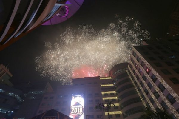 Fireworks light up the sky at the Eastwood Shopping Mall as Filipinos welcome the New Year Tuesday, Jan. 1, 2019 in suburban Quezon city northeast of Manila, Philippines. Filipinos welcome the New Year with the loudest noise possible including setting off powerful firecrackers in one of Asia's most violent celebrations despite a government scare campaign and threats of arrests.