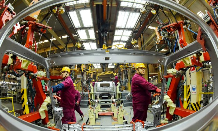 Employees work on a production line manufacturing light trucks at a JAC Motors plant in Weifang, Shandong Province, China on Nov. 30, 2018. (Reuters/Stringer/File Photo)
