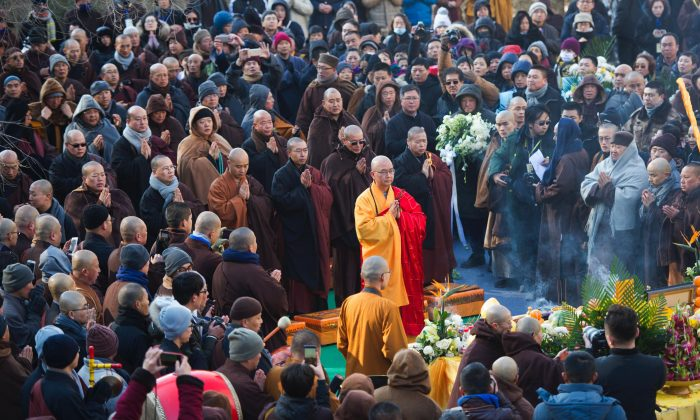 Xuecheng (c), the abbot of Beijing's Longquan Monastery, prays during a memorial event in China's Shanxi Province on Dec. 3, 2017. He was the former head of China's government-run Buddhist association and a Communist Party member. He was under criminal investigation for alleged sexual assault in 2018. ( STR/AFP/Getty Images)