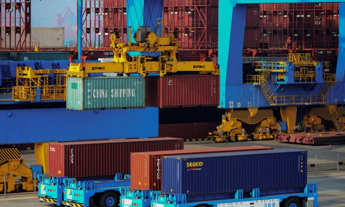Driverless trucks transferring containers at an automated cargo wharf in Qingdao City, Shandong Province, China, on Oct. 24, 2018. (STR/AFP/Getty Images)