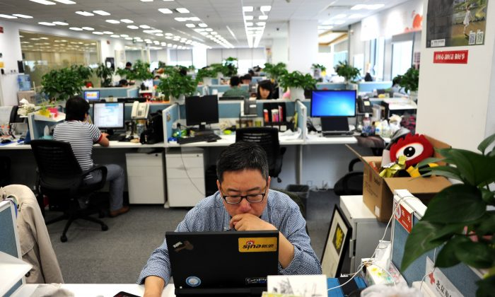 A man using a laptop at an office of Sina Weibo, widely known as China's version of Twitter, in Beijing, on April 16, 2014. (Wang Zhao/AFP/Getty Images)