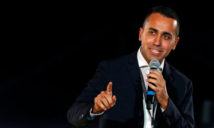 Italian Deputy PM Luigi Di Maio speaks at the 5-Star Movement party's open-air rally at Circo Massimo in Rome, Italy, on Oct. 20, 2018. (Reuters/Max Rossi)