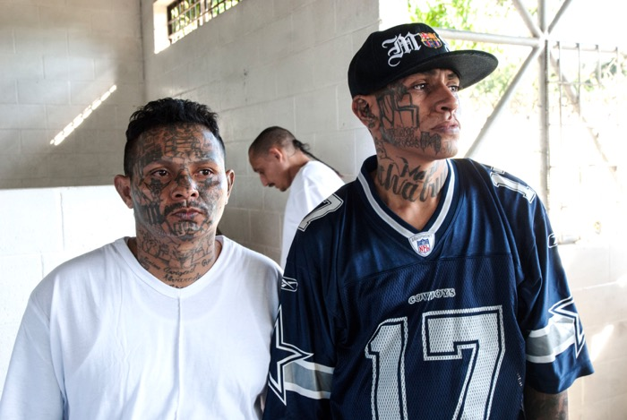 MS-13 gang members attend a conference.