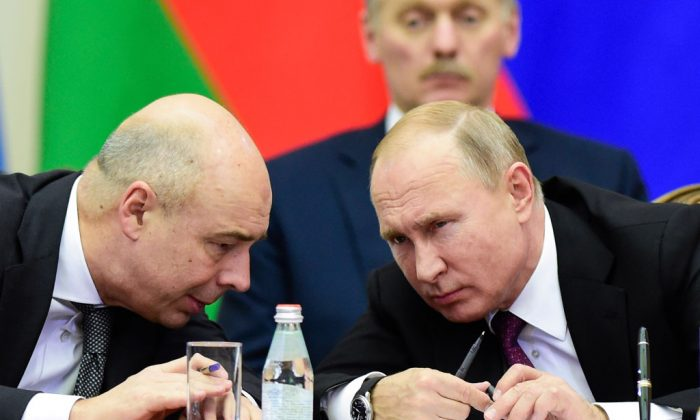 Russian President Vladimir Putin (R) and Finance Minister Anton Siluanov chat during a meeting of the Supreme Eurasian Economic Council in Saint Petersburg on Dec. 6, 2018. (Olga Maltseva/AFP/Getty Images)