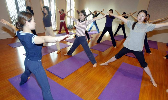 A group of Chinese women workout at a yoga class in Beijing 02 March 2005.  (STR/AFP/Getty Images)