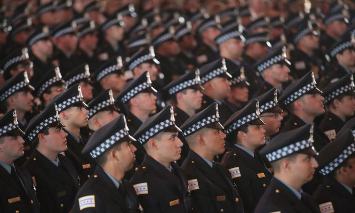 Chicago police officers attend a graduation and promotion ceremony in the Grand Ballroom on Navy Pier in Chicago, Ill., on June 15, 2017. (Scott Olson/Getty Images)