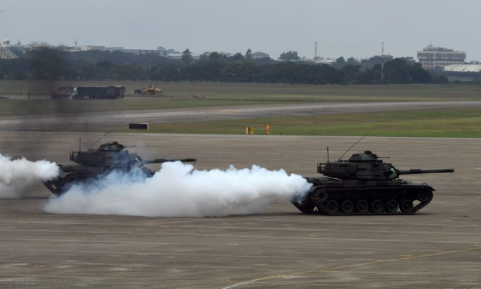 Two M60A3 tanks release smoke during the Han Kuang drill at the Ching Chuan Kang (CCK) air force base in Taichung, central Taiwan, on June 7, 2018. (SAM YEH/AFP/Getty Images)