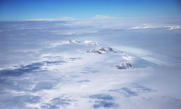 A section of the West Antarctic Ice Sheet with mountains is viewed from a window of a NASA Operation IceBridge airplane in-flight over Antarctica on Oct. 31, 2016.  (Mario Tama/Getty Images)