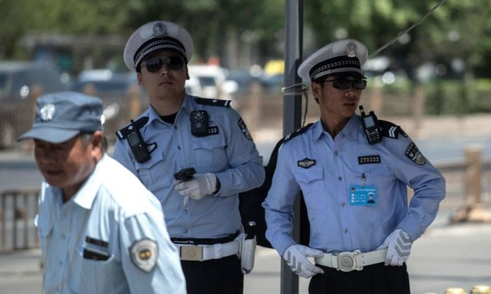 Police officers stand guard near Tiananmen Square in Beijing on June 4, 2018. (Fred Dufour/AFP/Getty Images)
