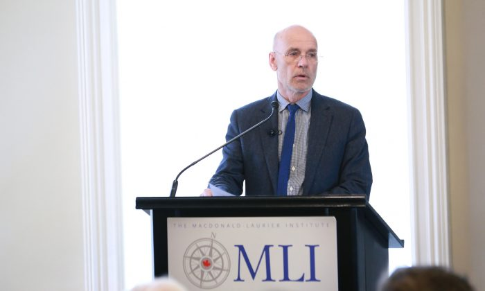 """Australian professor Clive Hamilton speaks about his ground-breaking book """"Silent Invasion"""" to an audience at the Macdonald-Laurier Institute in Ottawa on Oct. 16, 2018. (Courtesy of Macdonald-Laurier Institute)"""