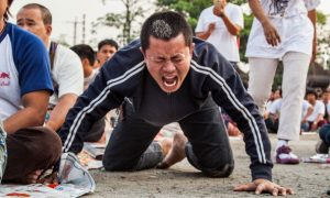 Chinese Company Forces Workers to Crawl Through Traffic as Punishment