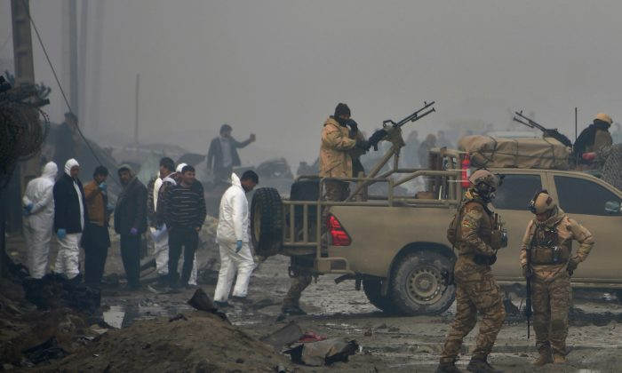 File photo showing Afghan security forces and investigators gather at the site of a suicide bomb attack outside a British security firm's compound in Kabul, Afghanistan, on Nov. 29, 2018. (Noorullah Shirzada/AFP/Getty Images)