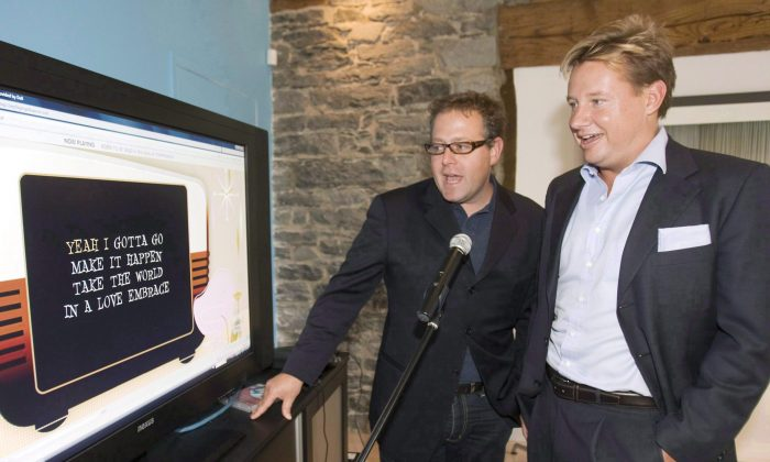 Eric Boyko (R), chief executive ofStingray, and co-founder Alexandre Taillefer at the company's headquarters in Montreal in this file photo. (The Canadian Press/Ryan Remiorz)