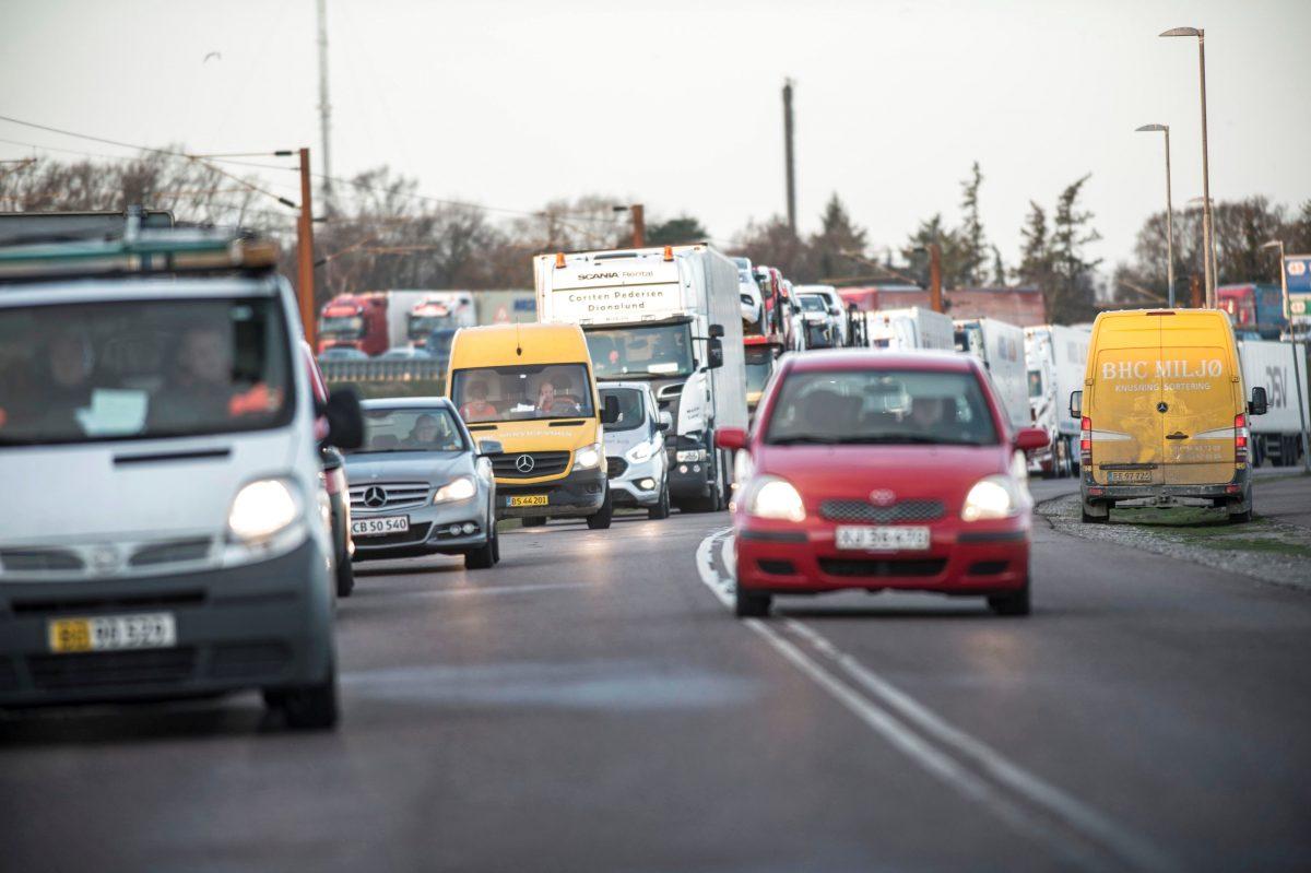 cars wait on bridge closed due to crash