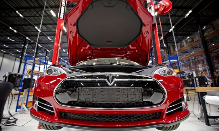 Fully electric Tesla car on an assembly line