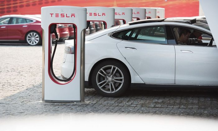 Tesla Model S being charged at a car dealership in Shanghai on March 17, 2015. (Johannes Eisele/AFP/Getty Images)