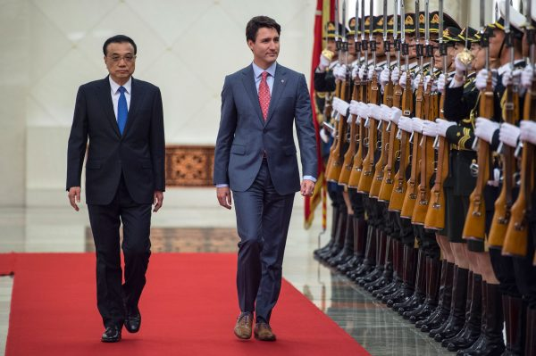 Canada's Prime Minister Justin Trudeau and China's Premier Li Keqiang walk during a review of Chinese paramilitary guards Beijing, China on Dec. 4, 2017. (Fred Dufour/AFP/Getty Images)
