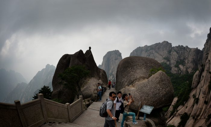 Chinese tourists hiking on Lotus Peak which is the most revered of the Huangshan (Yellow Mountains) peaks at the park in Anhui Province.  The UNESCO World Heritage Site is one of China's major tourist destinations and has been a source of inspiration to Chinese painters, writers and poets for thousands of years. (Mark Ralston/AFP/Getty Images)