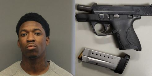 Darrell Rhyme, 23, was caught shortly after midnight on New Year's Eve with a stolen gun, the Chicago Police Department said. (Chicago Police Department)