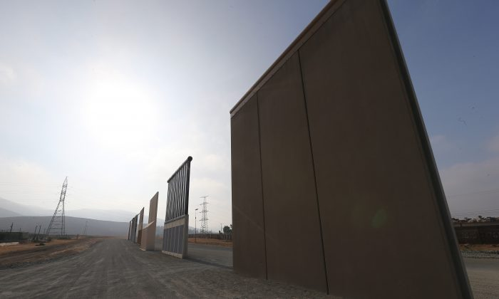 U.S President Donald Trump's border wall prototypes stand near the U.S.-Mexico border in San Diego, Calif., on July 16, 2018. (Mario Tama/Getty Images)