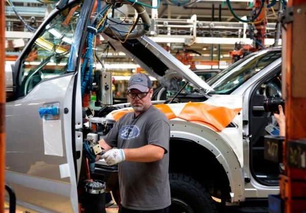 An employee works on the assembly line for the Ford 2018. (JEFF KOWALSKY/AFP/Getty Images)
