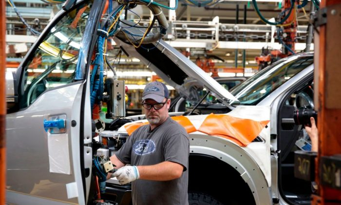 An employee works on the assembly line for the Ford 2018 and 2019 F-150 truck at the Ford Motor Company's Rouge Complex in Dearborn, Michigan, on Sept. 27, 2018 . (JEFF KOWALSKY/AFP/Getty Images)