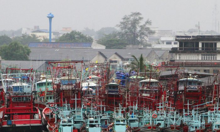 Fishing boats are seen docked at a port as tropical storm Pabuk approaches the southern province of Pattani, Thailand, on Jan. 3, 2019. (Reuters/Surapan Boonthanom)