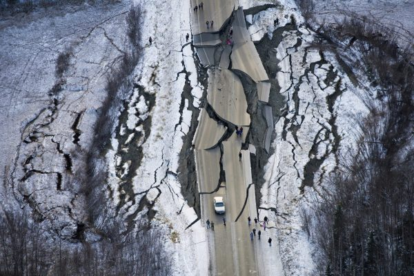 This aerial photo shows damage on Vine Road, south of Wasilla, Alaska