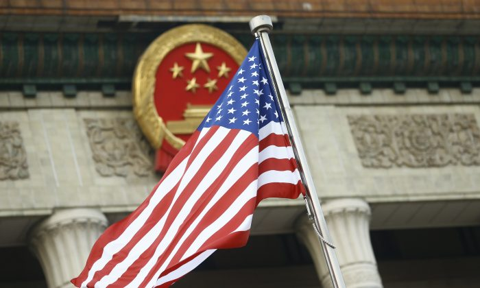 The U.S. flag flies at a welcoming ceremony between Chinese leader Xi Jinping and U.S. President Donald Trump in Beijing on Nov. 9, 2017. Trump was on a 10-day trip to Asia. (Thomas Peter/Pool/Getty Images)
