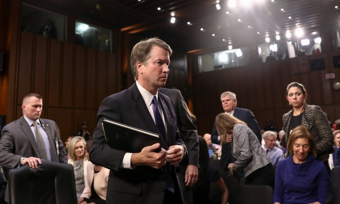 Judge Brett Kavanaugh departs after testifying before the Senate Judiciary Committee during the first day of his confirmation hearing  to serve as Associate Justice on the U.S. Supreme Court at the Capitol in Washington on Sept. 4, 2018. (Samira Bouaou/The Epoch Times)