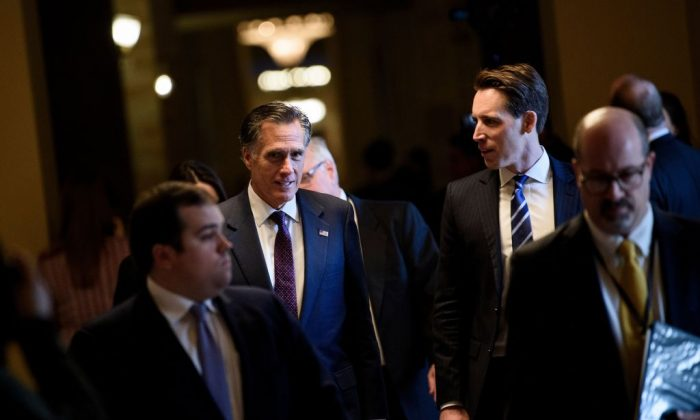 Incoming Senator Mitt Romney (R-Utah) leaves a meeting after Republican members of the Senate met to elect their leadership on Capitol Hill in Washington on Nov. 14, 2018. (Brendan Smialowski/AFP/Getty Images)