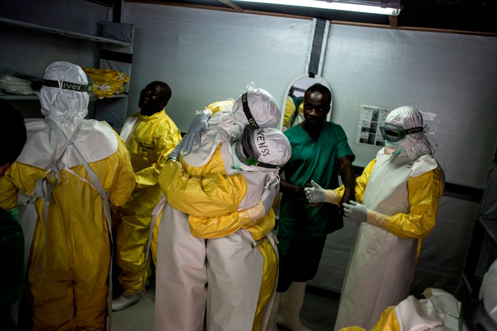 doctors embrace before heading into ebola treatment center