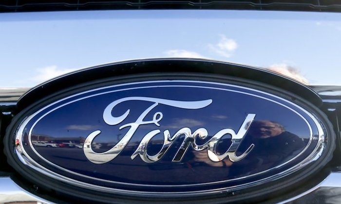 Blue Ford oval badge in the grill of a pickup truck on the sales lot at Butler County Ford in Butler, Pa. On Nov. 19, 2015. (AP Photo/Keith Srakocic)