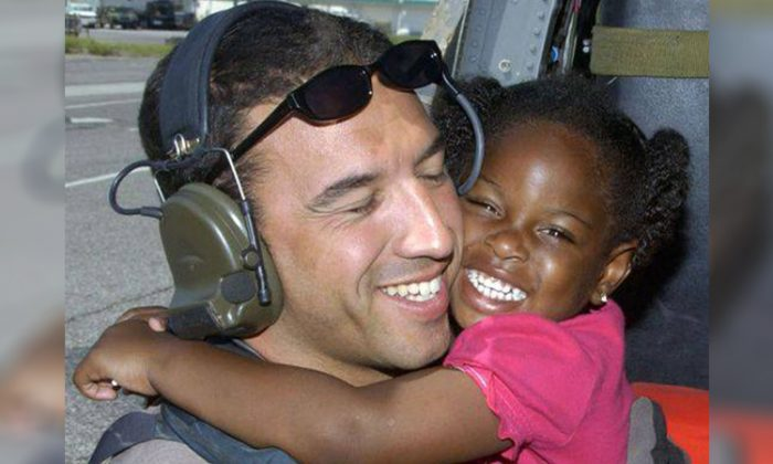 LaSandra Shay hugs Sgt. Mike Maroney, pararescuer, after he saved her from Hurricane Katrina on Aug. 23, 2005. (U.S. Air Force | Airman 1st Class Veronica Pierce)