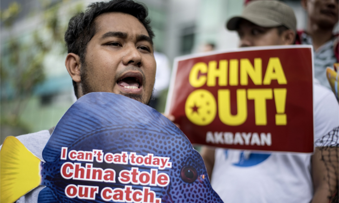 Activists hold placards during a protest in front of the Chinese Consular Office in Manila on June 11, 2018. (Noel Celsis/AFP/Getty Images)