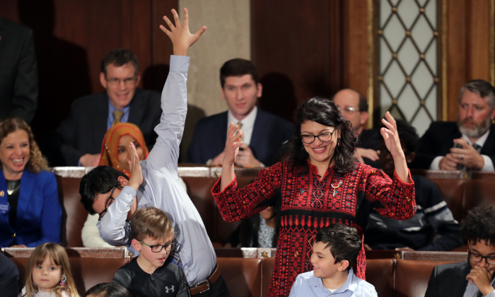 Rep. Rashida Tlaib (D-MI) votes for Speaker-designate Rep. Nancy Pelosi (D-CA) along with her kids during the first session of the 116th Congress at the U.S. Capitol January 03, 2019 in Washington, DC. (Chip Somodevilla/Getty Images)