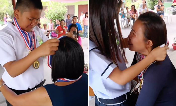 Filipino students give their academic achievement medals to their mothers, who are Overseas Filipino Workers (OFWs). (Facebook Video Screenshot | Labstore)