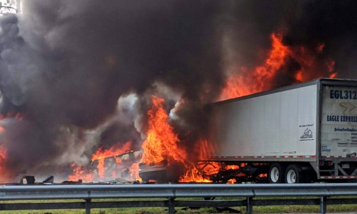 Flames engulf vehicles after a fiery crash along Interstate 75, Thursday, Jan. 3, 2019, about a mile south of Alachua, near Gainesville, Fla. Highway officials say at least six people have died after a crash and diesel fuel spill sparked a massive fire along the Florida interstate. (WGFL-Gainesville/AP)