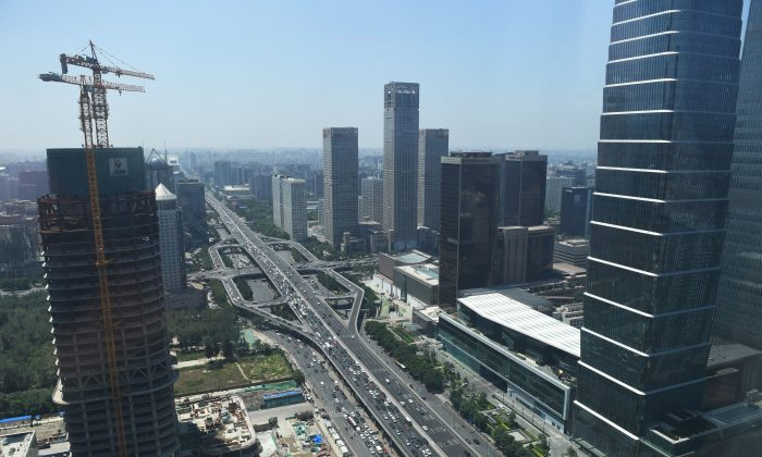 Buildings are seen under construction in the central business district of Beijing on June 14, 2018. (Greg Baker/AFP/Getty Images)
