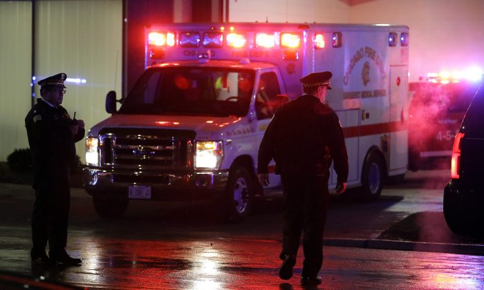 A stock photo shows an ambulance with lights flashing. (Joshua Lott/Getty Images)